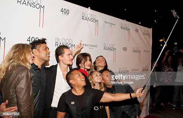 Publicist Rembrandt Flores takes a selfie with actress Kristin Bauer van Straten, director Francis dela Torre, actor Alexander Dreymon and actresses...