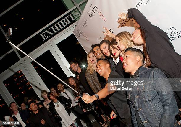 Publicist Rembrandt Flores takes a selfie with actress Kristin Bauer van Straten director Francis dela Torre actor Alexander Dreymon and actresses...