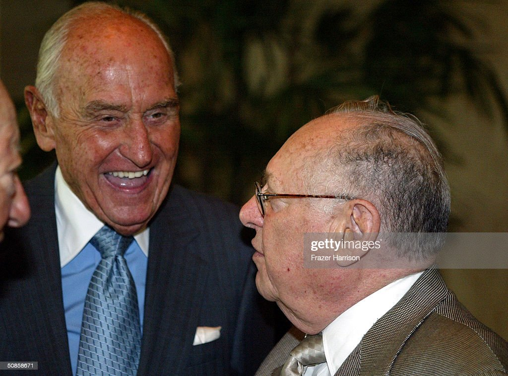 Publicists Lee Solters (R) talks with producer A.C. Lyles (L) at the VIP luncheon to celebrate the 50th Anniversary of Solters & Digney Public Relations, and its founder Lee Solters, held on May 19, 2004 at the Beverly Hilton Hotel in Beverly Hills, California.
