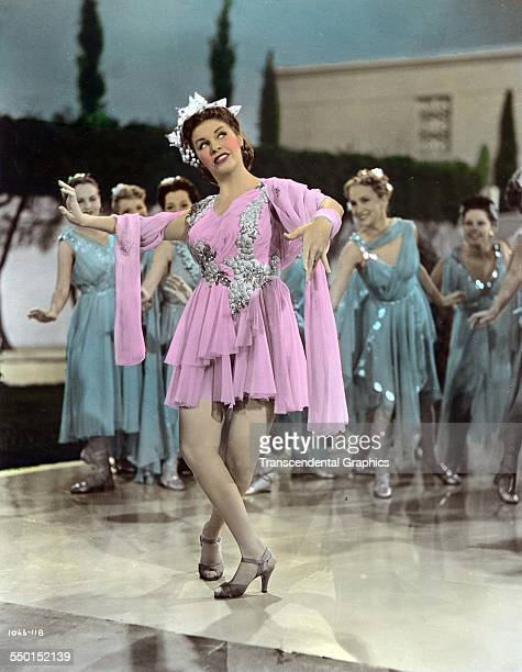 Publicity color photograph of a Martha Raye as she dances in 'The Boys of Syracuse' Hollywood California 1940