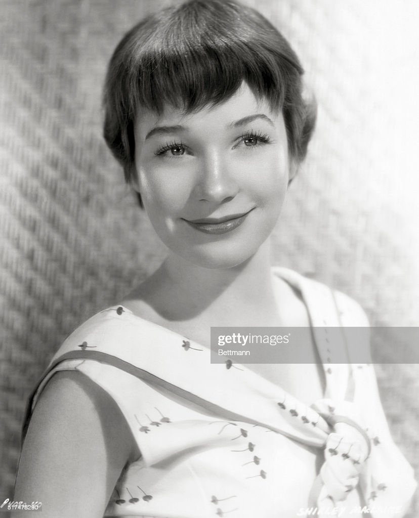 Publicity handout for actress Shirley MacLaine. Portrait, black and white, smiling for Paramont Pictures and Hal Wallis Productions. Undated publicity handout, circa 1955.