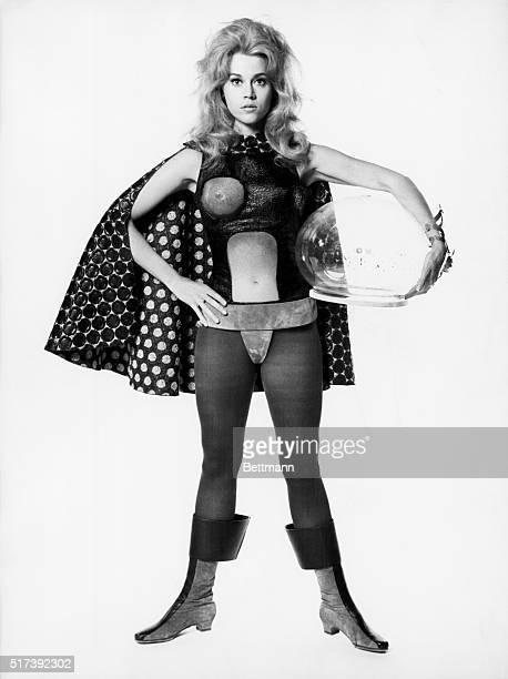 Publicity handout for the 1968 film 'Barbarella' with Jane Fonda in tights bodysuit cape boots and holding a plastic helmet