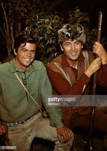 Publicity handout form the 1960s television Western Daniel Boone In costume Fess Parker in the title role and Darby Hinton as Israel Boone smile...
