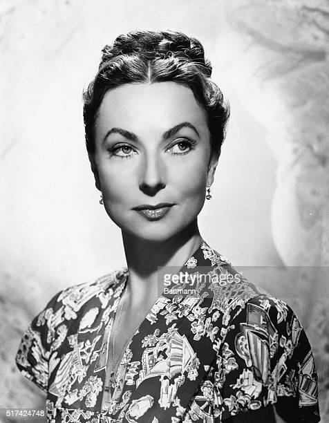 Publicity handout of actress Agnes Moorehead she is shown from the shoulders upwearing a printed dress with her hair pinned up in a braidedbun...
