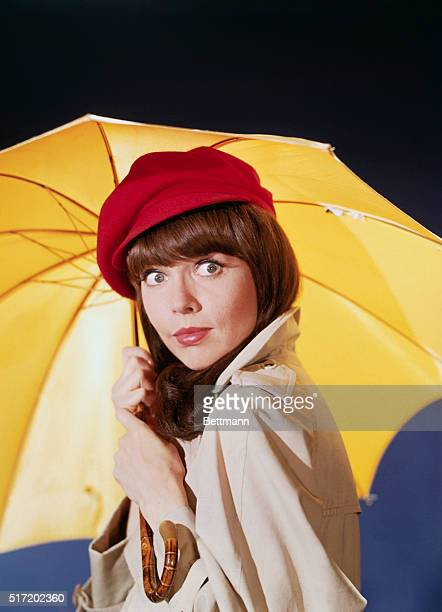 Publicity handout of Barbara Feldon in TV series Get Smart Photo shows Barbara Feldon wearing a raincoat and red hat holding a yellow umbrella