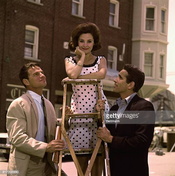 Publicity handout of film and television actress Rita Moreno born in Puerto Rico in 1931 standing on a ladder wearing black and white polka dotted...