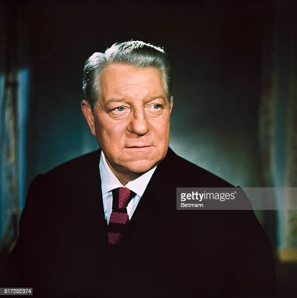 Publicity handout of French born actor Jean Gabin . Head and shoulders shot of Gabin wearing a suit and tie.