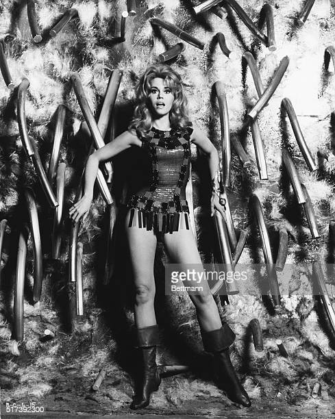 Publicity photo for the 1968 film Barbarella with Jane Fonda standing in front of a tubular morass wearing a body suit with plastic fringe around the...