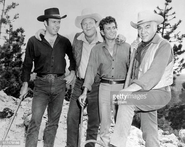 Publicity photo from the TV series Bonanza left to right are Pernell Roberts as Adam Cartwright Dan Blocker as Hoss Cartwright Mike Landon as Little...