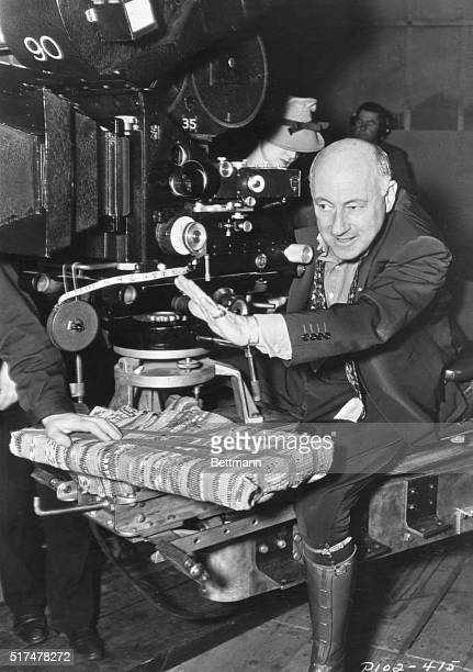 Publicity photo of Cecil B DeMille behind the camera