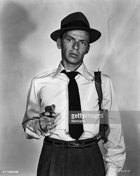 Publicity Photo of Frank Sinatra holding a gun as John Baron in the 1954 film Suddenly