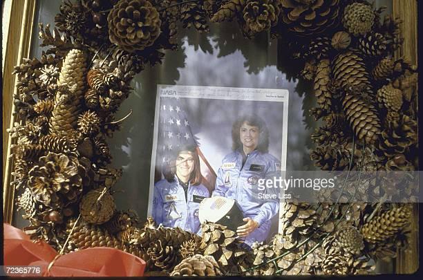 NASA publicity photo of teacher in space Sharon Christa McAuliffe and her alternate Barbara Morgan with memorial wreath hanging on door in...
