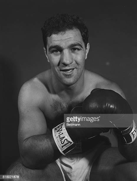 Publicity photo shows heavyweight champion boxer Rocky Marciano in the ring leaning on the ropes