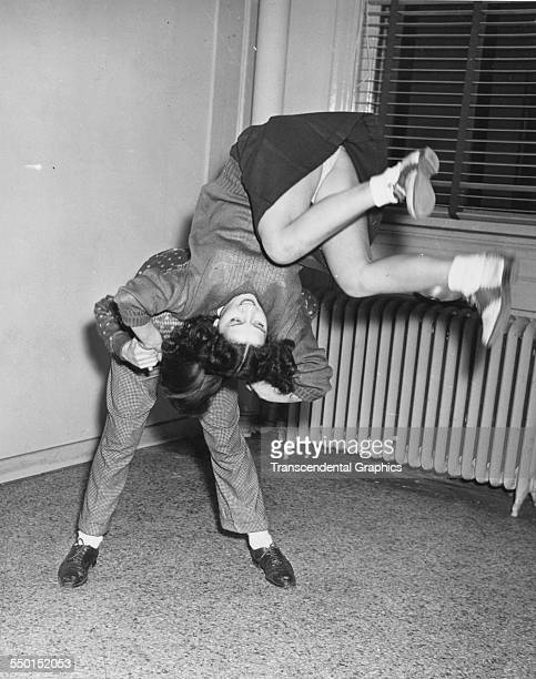 A publicity photograph by the Scotty Bjurstrom Agency showing wild teenage dancing the latest craze Chicago Illinois circa 1950