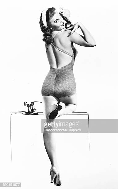 Publicity photograph for the Bjurstrom Agency featuring a scene with a telephone call by model Joan Caulfield Chicago Illinois circa 1945