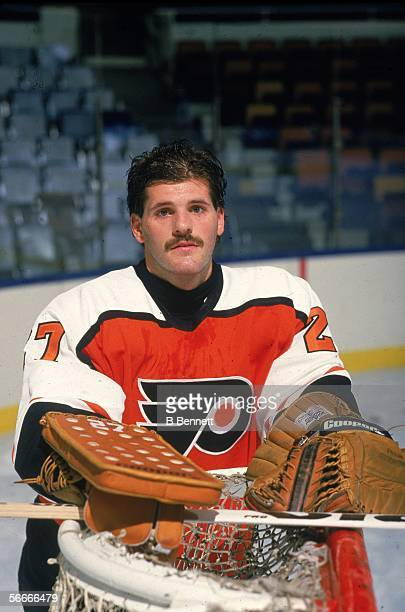 Publicity photograph of Canadian professional hockey player Ron Hextall goalie for the Philadelphia Flyers who poses near the goal post 1988 1999...