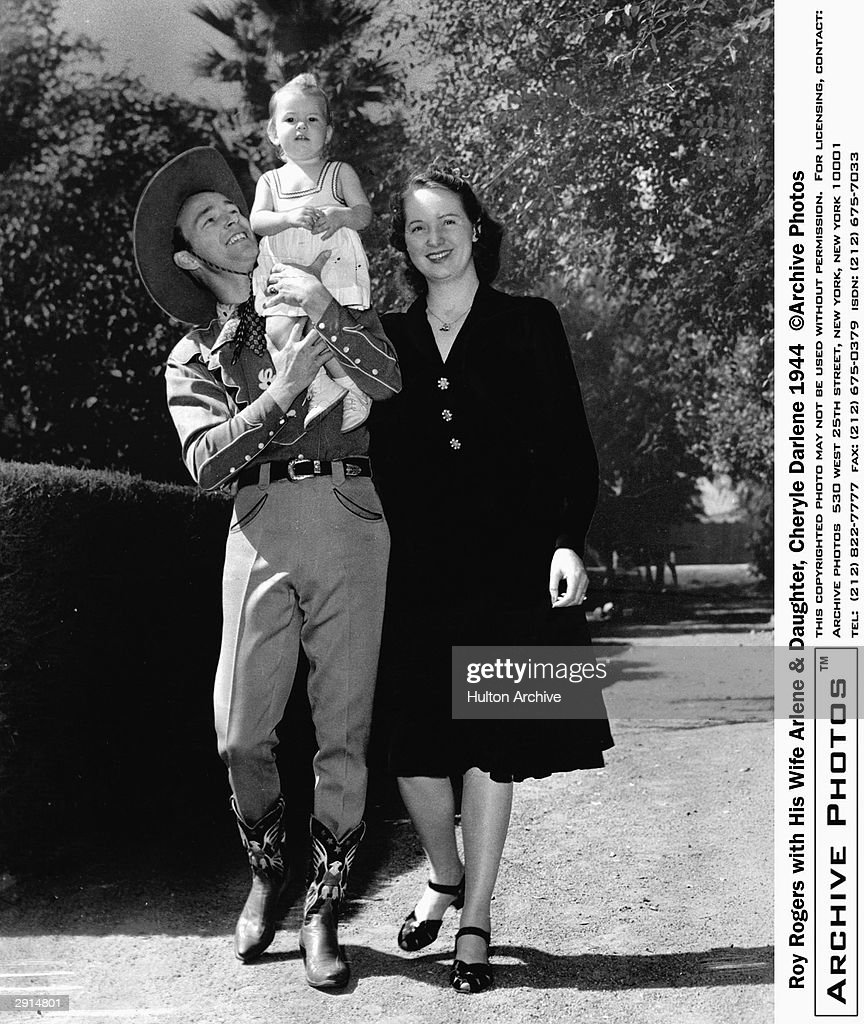 Publicity portrait of American actor and star of western films, Roy Rogers (1911 - 1998), with his first wife Arlene and their 2-year-old daughter, Cheryl Darlene, 1944.