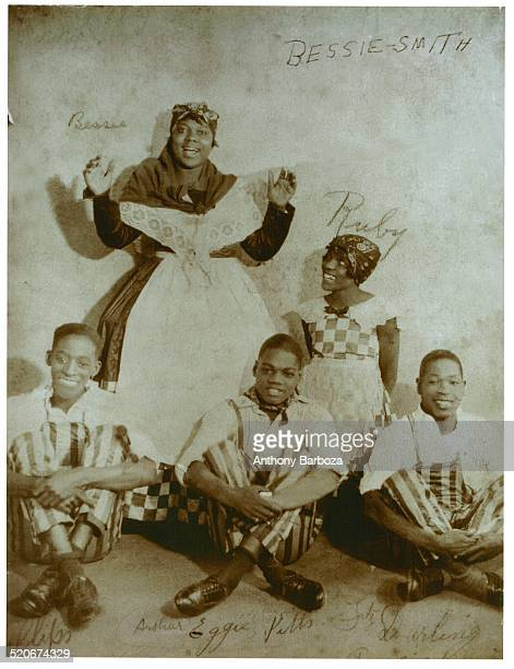 Publicity portrait of American blues singers Bessie Smith and her neice Ruby Smith as they pose with song and dance trio the Dancing Sheiks led by...