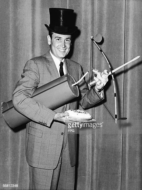 Publicity portrait of American radio and television show host Bob Barker as he poses with a number of props in preparation for hosting the television...