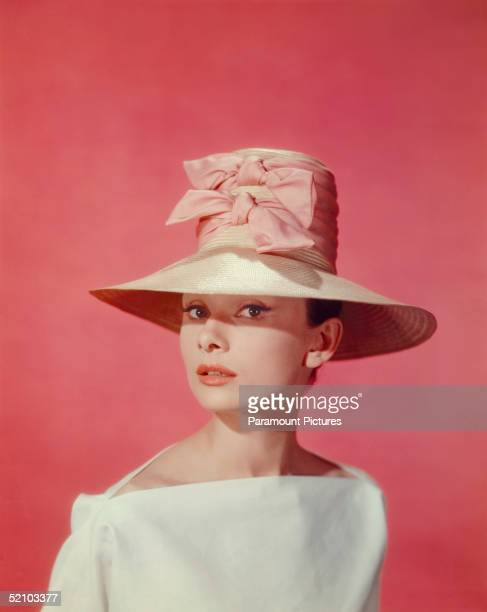 Publicity portrait of Belgianborn American actress Audrey Hepburn as she wears a widebrimmed hat and white blouse during the filming of the film...