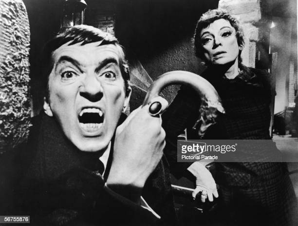 Publicity portrait of Canadian actor Jonathon Frid, a metal-tipped cane in his hand as he bares his fangs as the vampire character Barnabas Collins,...