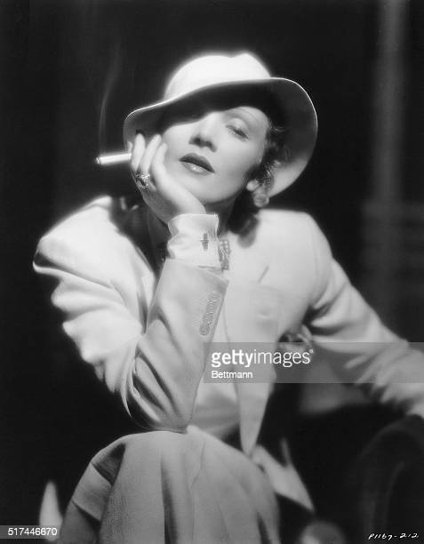 """Publicity portrait of Marlene Dietrich , Berlin-born actress famous for films such as """"Morocco"""" and """"Blond Venus"""" . She is shown here holding a..."""