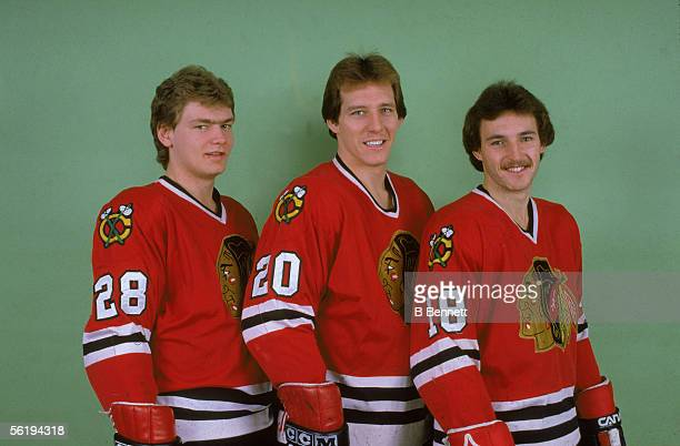 Publicity portrait of three of members of the Chicago Blackhawks ice hockey team 19821983 season From left Canadians Steve Larmer Al Secord and Denis...
