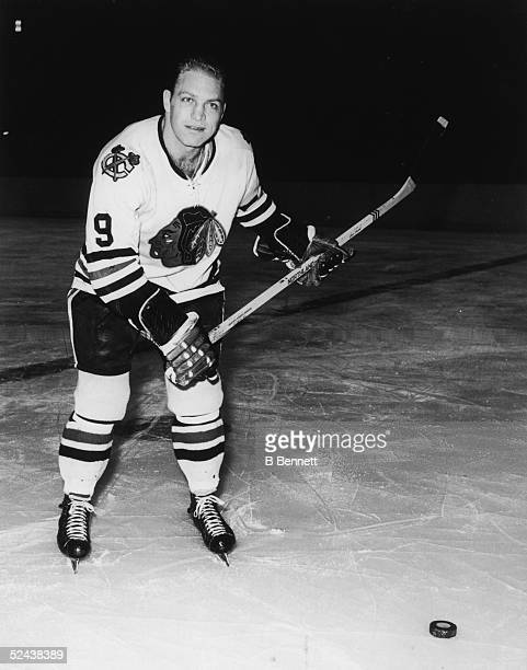 Publicity shot of Canadian hockey player Bobby Hull of the Chicago Blackhawks as he poses with the puck 1960s