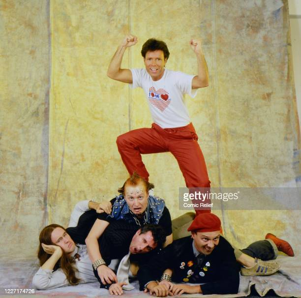 """Publicity shots for """"Living Doll', the million-selling single and video released by Comic Relief on 28th April 1986 with Cliff Richard and the Young..."""
