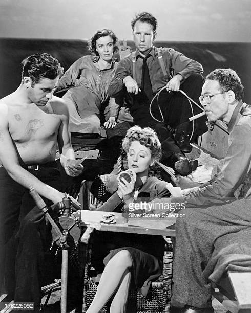 A publicity still for 'Lifeboat' directed by Alfred Hitchcock 1944 The cast are John Hodiak Mary Anderson Hume Cronyn Henry Hull and Tallulah Bankhead