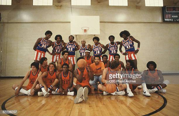 Publicity still from the CBS drama series 'The White Shadow' shows special guests the Harlem Globetrotters basketball team as they stand behind the...
