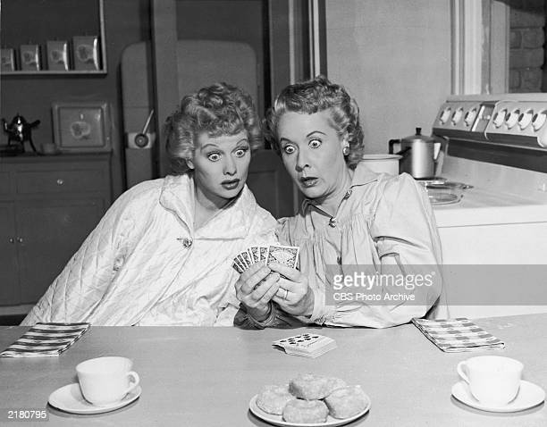 Publicity still from the television series 'I Love Lucy' shows American actors Lucille Ball as Lucy Ricardo and Vivian Vance as Ethel Mertz sitting...