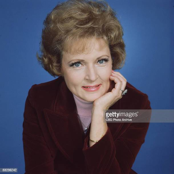Publicity still of American actress Betty White who plays Sue Ann Nivens on 'The Mary Tyler Moore Show' 1975 She wears a burgandy velvet jacket over...