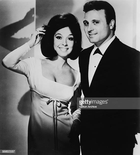Publicity still of American pop singers and brothersister duo Nino Tempo and April Stevens 1960s Stevens who wears a scoopneck dress adjusts her hair...