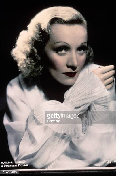 Publicity still of Marlene Dietrich wearing white blouse. Undated hand tinted photograph.