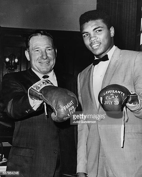 July 13 1962'YOU'RE INVITED'Cassius Clay right who boxes Alejandro Lavorante on the Fight for Lives show at the Sports Arena a week from tonight took...