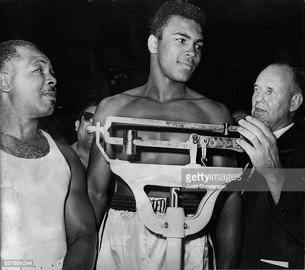 November 16 1962FRIENDLY MEETINGVeteran Archie Moore left and youthful Cassius Clay appear friendly as they were weighed in Thursday morning by...