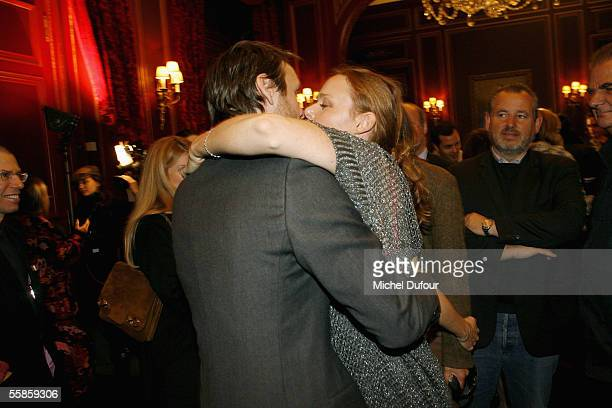 Publisher Alasdhair Willis and wife designer Stella McCartney kiss backstage at the Stella McCartney show as part of Paris Fashion Week PretaPorter...