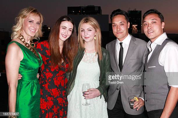 Publisher Alison Miller Madeline Zima guest Jonnie and Mark Houston post at the Los Angeles Confidential Celebrates The Men of the October Issue at W...