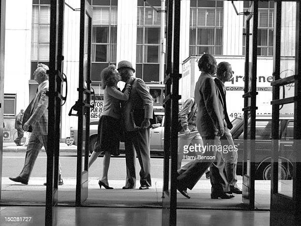 Publisher and author Helen Gurley Brown photographed outside the Cosmopolitan offices kissing her husband David Brown goodbye, one morning, in 1982...