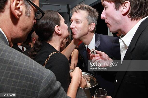 Publisher and editor-in-chief of AnOther Magazine Jefferson Hack hands dessert out during the Another Magazine dinner at Milk Studios on September...