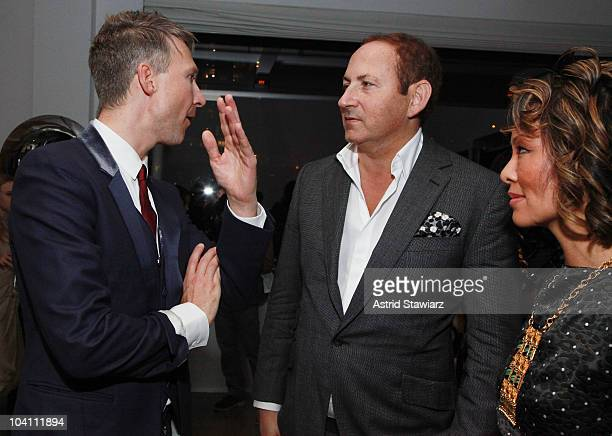 Publisher and editor-in-chief of AnOther Magazine Jefferson Hack talks with designer John Demsey and Alina Cho at the Another Magazine dinner at Milk...