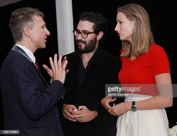 Publisher and editorinchief of AnOther Magazine Jefferson Hack talks with designer Adam Kimmel and Leelee Sobieski at the Another Magazine dinner at...