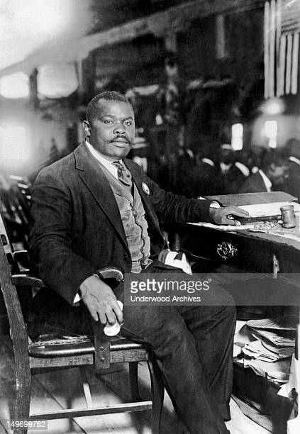 Publisher and orator Marcus Garvey seated at his desk August 5 1924