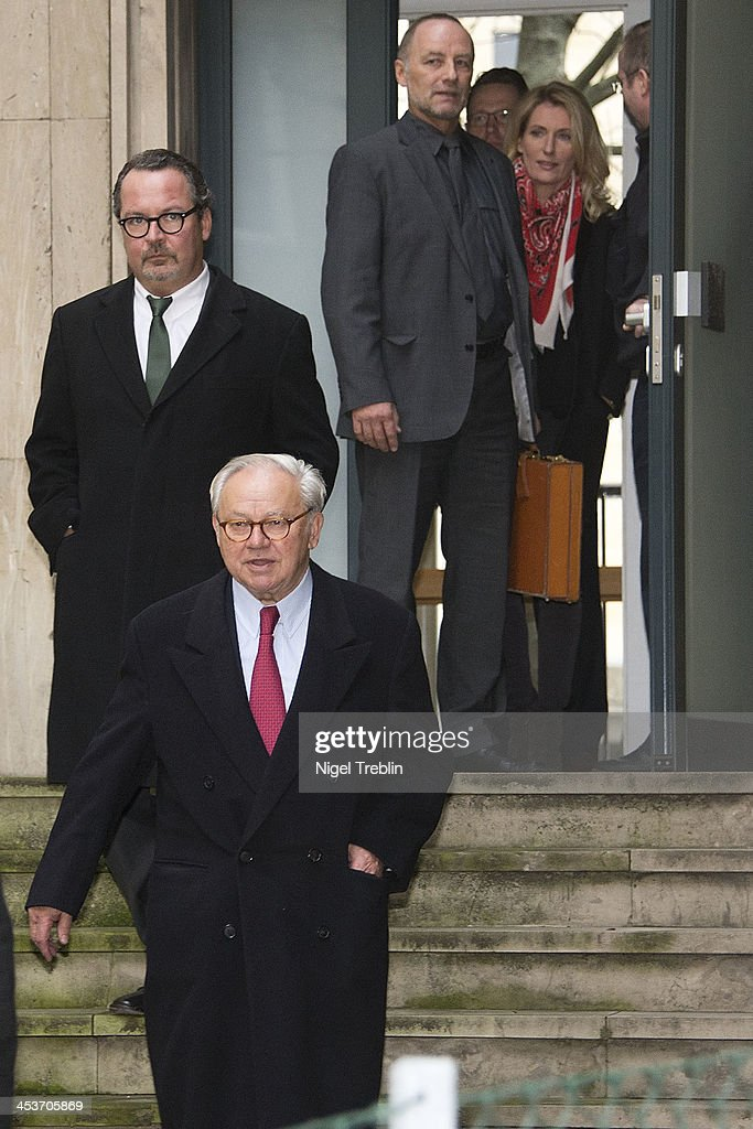 Publisher Hubert Burda (L) and his wife, actress Maria Furtwaengler (R), leaves the the Landgericht Hannover courthouse after the trial of former German President Christian Wulff on December 5, 2013 in Hanover, Germany. Wulff is accused of allowing film producer David Groenewold to pay for a Munich hotel booking while Wulff was governor of Lower Saxony in exchange for Wulff's support in promoting one of Groenewold's films. Wulff is the first post-World War II German president to face a court trial.