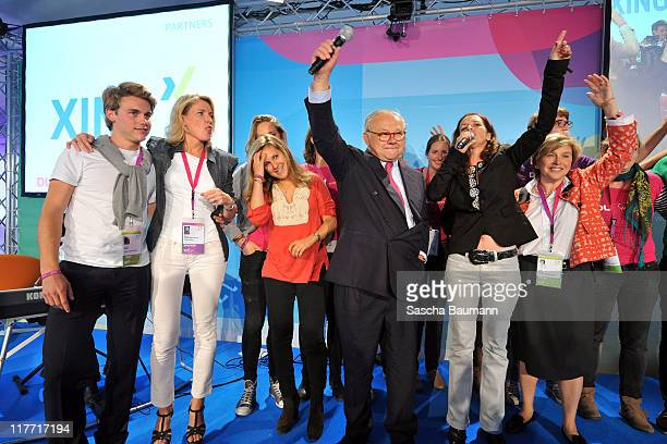 Publisher Hubert Burda his wife Maria Furtwaengler and their children Jacob and Elisabeth singer Judy Weiss and DLD founder Steffi Czerny sing during...