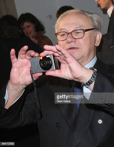 Publisher Hubert Burda takes a snapshot while attending the DLD Star Night at Haus der Kunst on January 26 2009 in Munich Germany