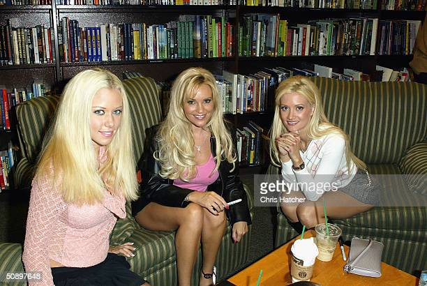 Publisher Hugh Hefner girlfriends Bridget Kendra and Holly Madison sit down and relax at his new book signing of Hef's Little Black Book on May 25...