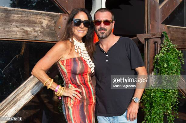 Publisher Lynn Scotti and John Amato attend the Hamptons Magazine x The Chainsmokers VIP Dinner at The Barn at Nova's Ark on July 25, 2020 in...