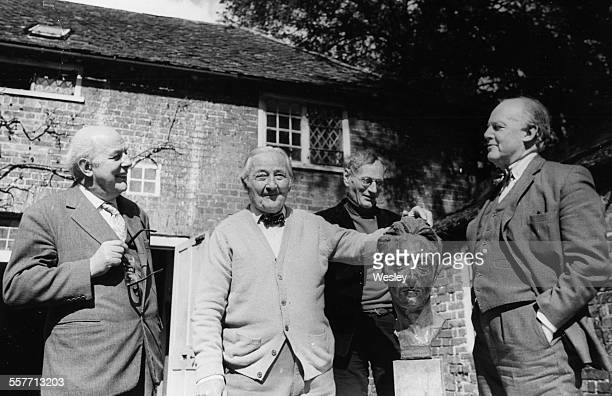 Publisher Martin Secker smiling as he celebrated his 90th birthday, with Sir John Betjeman, Lord Horder and Terence De Vere White, standing around a...